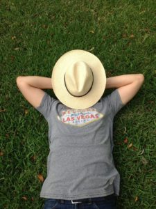 Man lying in the grass with a hat