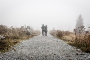 Couple walking in the fog