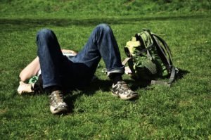 Man lying in the grass recovering from Alcohol Abuse
