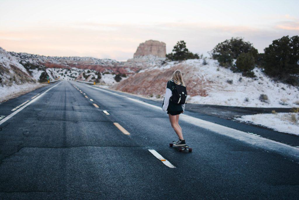 Teen skate boarding