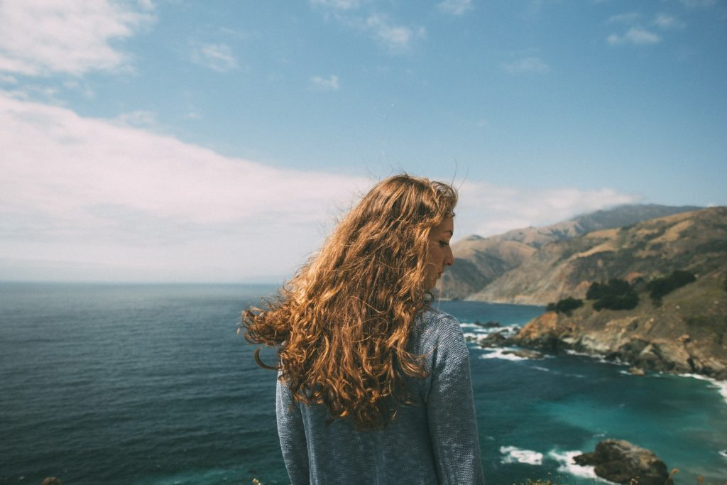 Girl by the ocean struggling with opioid addiction