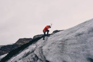 Man climbing a mountain