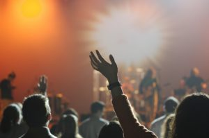 People at a concert and some deal with Compulsive Sexual Behavior