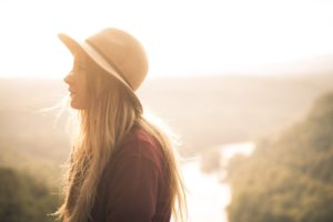 Woman in hat struggling with co-occurring addictions
