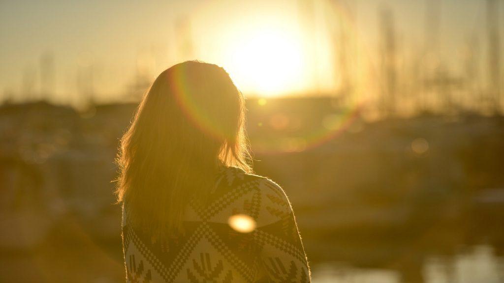 Woman sitting watching the sunset