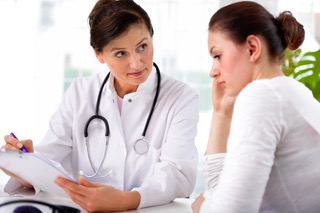 doctor with woman patient using weight-loss drug