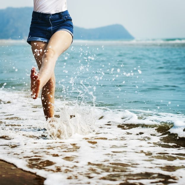 Women kicking in the ocean