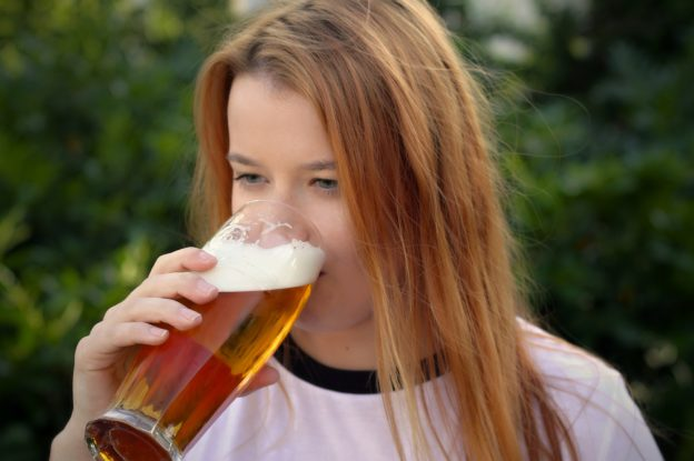 College woman drinking alcohol
