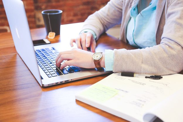 Woman researching Pseudoephedrine Abuse on her laptop