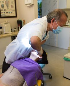 Dentist Pulling on Tooth