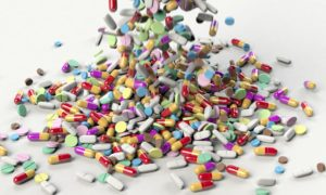 Pills Falling on to Table