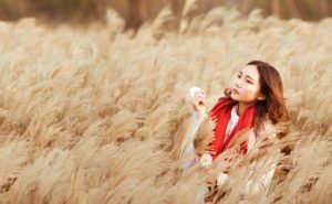 Asian American Woman or Girl in Wheat Field