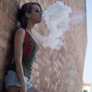 Teen Vaping Blowing Out Smoke
