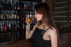 Woman Drinking Martini at Bar
