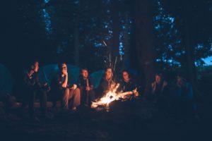 Girls around bonfire