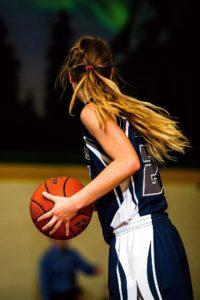 Female Athletes playing basketball