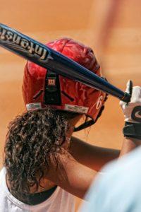 Female athletes playing softball