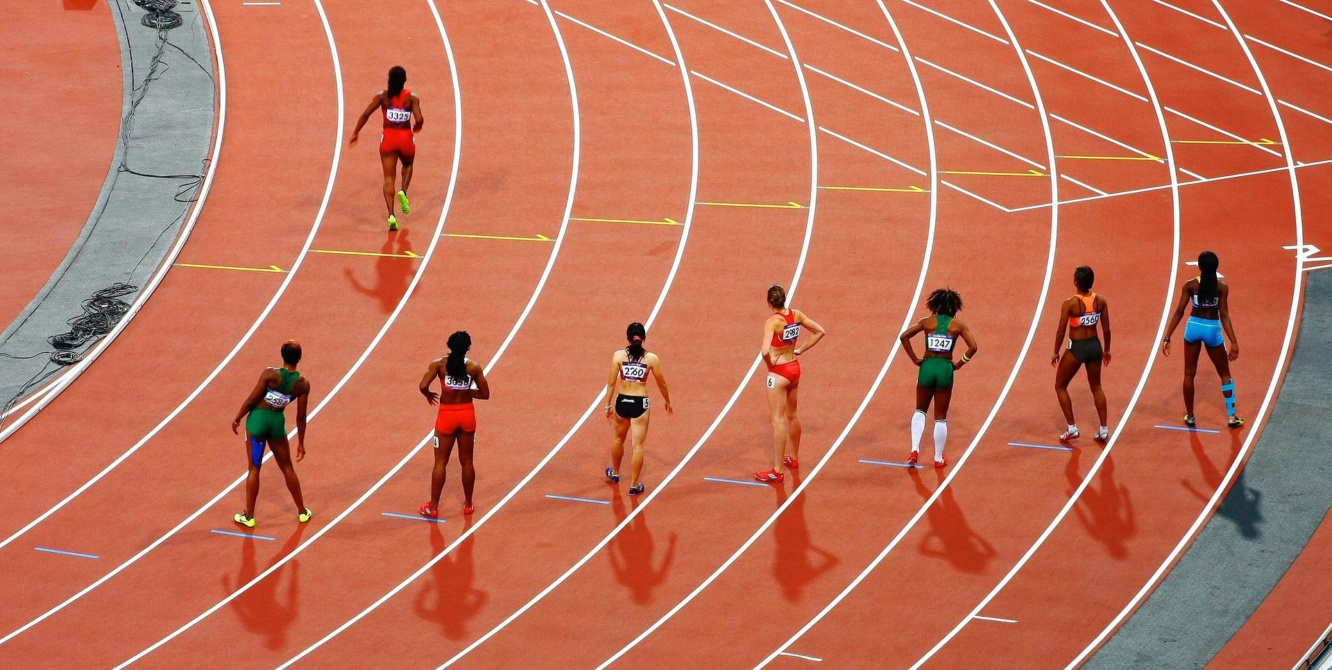 Women Athletes on Running Race Track